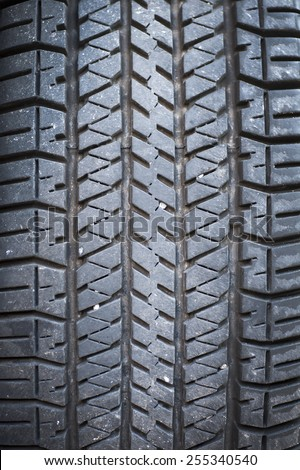 A black rubber tyre, Background.