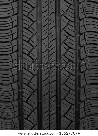 A black rubber tyre isolated against a white background - stock photo