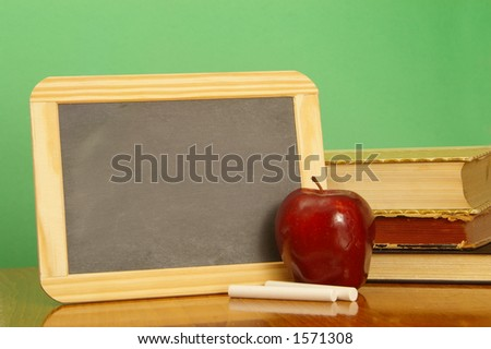 A black school slate ready to deliver your message. - stock photo