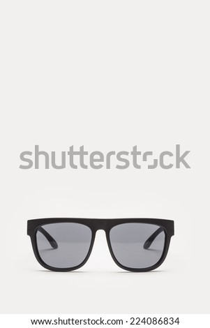 A black sunglasses front view isolated white. - stock photo