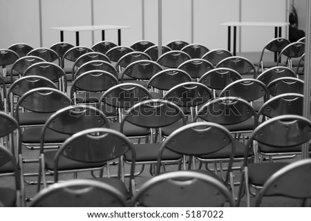 A black-white photo of a conference room - stock photo