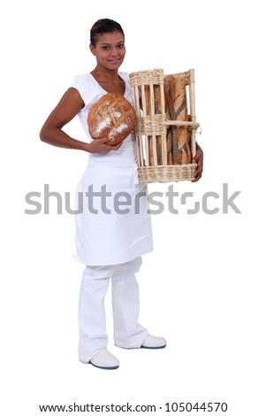 A black woman baker. - stock photo