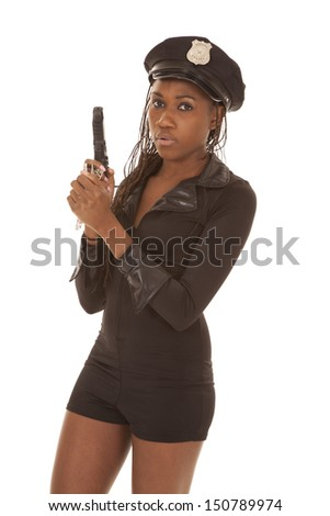 A black woman is holding a gun dressed as a cop