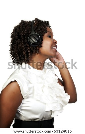 A black woman with headphones listening to music or learning a language - stock photo