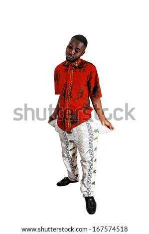 A black young man standing for white background turned his pockets out to show he has no money.