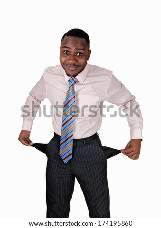 A black young man standing for white background turned his pockets out to show he has no money.  - stock photo