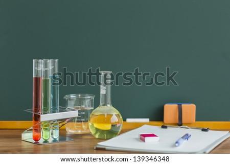 A blackboard and labware - stock photo
