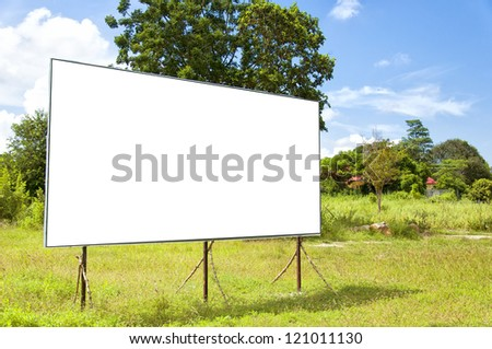 A blank bilboard situated in a rural location. - stock photo