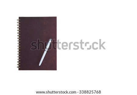 A blank brown book(note, diary) cover isolated on white background, top view at the studio