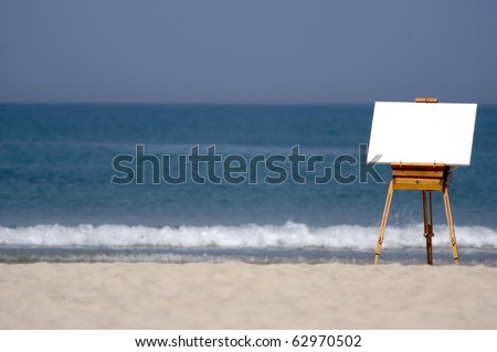 A blank canvas rests on a easel of a beach. copy space. Concept photo of art , artwork, craftsmanship, ad, advertising, advertisement, advertisement, business, artist, ,showing design and display.  , - stock photo