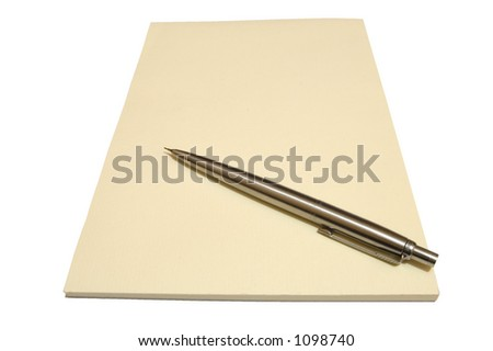A blank cream writing pad with a metal pen. - stock photo