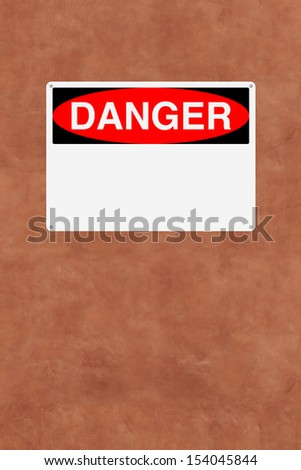 A blank danger sign mounted on a wall