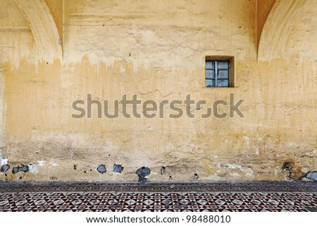 A blank grungy gothic mason wall with space for text. - stock photo
