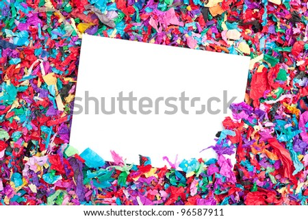 A blank invitation in a pile of colorful confetti.  Good for any celebration event.  Designers can place copy on the white card.