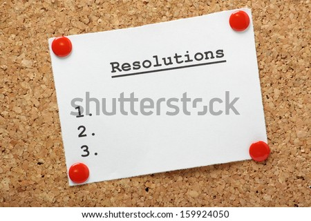 A blank list of resolutions for new year or in general pinned to a cork notice board with room for your text. - stock photo