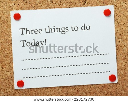 A blank list of Three Things to do Today! pinned to a cork notice board. A short list of objectives often motivates us to get things done. - stock photo