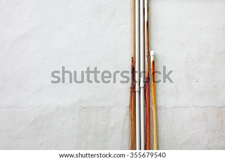 A blank mason wall with rusty leaking pipes.   - stock photo