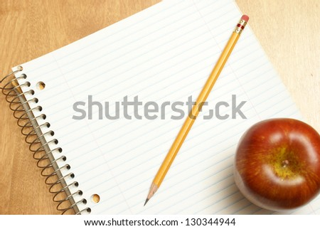A blank notebook for someone to write on while sitting at their desk. - stock photo