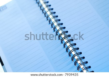 A blank page in a spiral bound notebook, with clipping path.