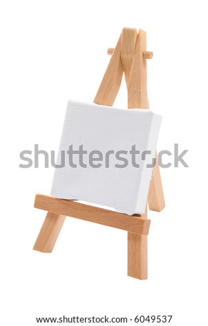 A blank stretched artist's canvas on an easel