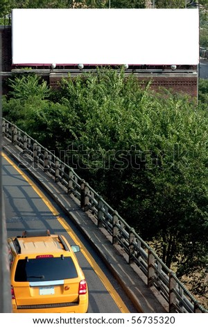 A blank urban highway billboard advertisement on the side of the highway in the city.  Great for giving some life your design mockup or proof. - stock photo