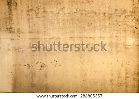 A blank, weather-patterned concrete wall perfect for backgrounds and messages.