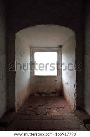 A blank window opening in an ancient stonemason chamber.  - stock photo