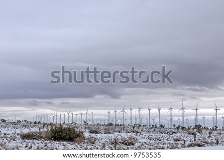 A blanket of snow around the Tehachapi Wind Farm and surrounding areas after a powerful winter storm. The Tehachapi Wind Farm in southern California's Kern county. - stock photo