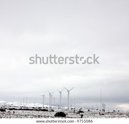 A blanket of snow around the Tehachapi Wind Farm and surrounding areas after a powerful winter storm. - stock photo