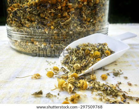 A blend of loose herbal tea with lavender, chamomile and lemon verbena. - stock photo