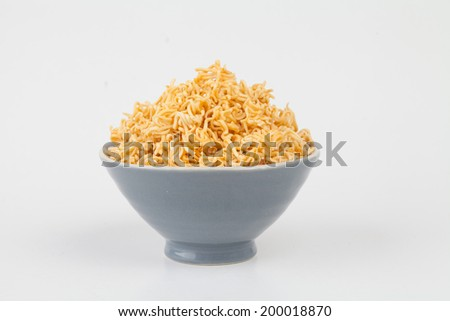 A block of dried Instant noodles on dish with gray background - stock photo