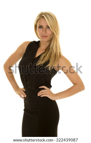 A blond business woman in her black dress with a small smile on her lips, and a determined expression on her face.