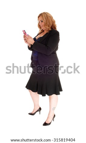 A blond plus size business woman in a black jacket dealing on her cell phone, standing in profile isolated for white background.  - stock photo
