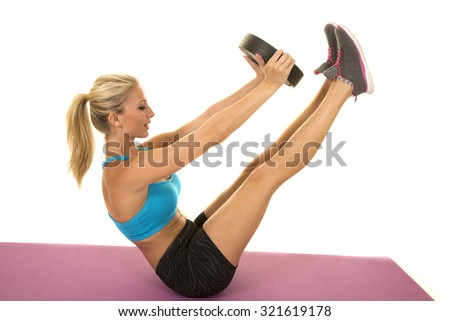 A blond woman doing a exercise with a weight.