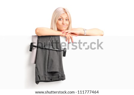 A blond woman dressing up behind panel isolated on white background - stock photo