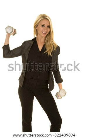 A blond woman in her business clothing working out with fitness weights.