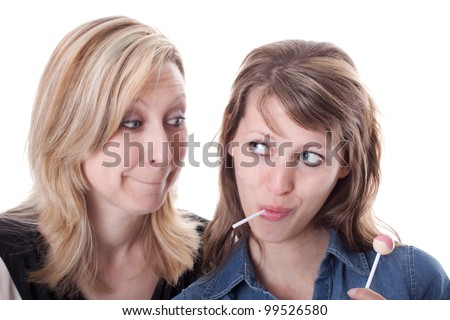 a blond woman wants the sweets from the brunette woman - stock photo