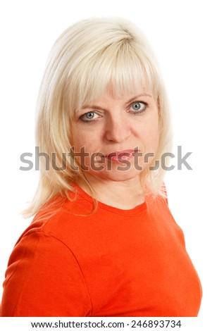 A blond woman wearing a orange top - stock photo
