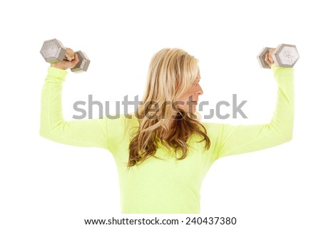 a blond woman working out with weights, looking to the side. - stock photo