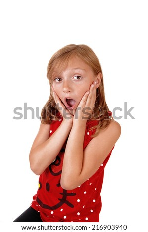 A blond young girl with a wait open mouth can not believe what she sea's, isolated on white background.  - stock photo