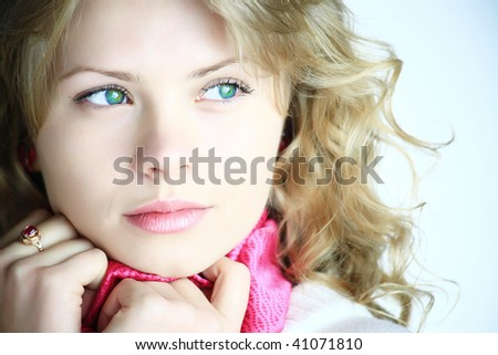 A blond young woman looking - stock photo