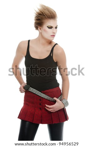 a blonde girl posing in a punk style outfit - stock photo