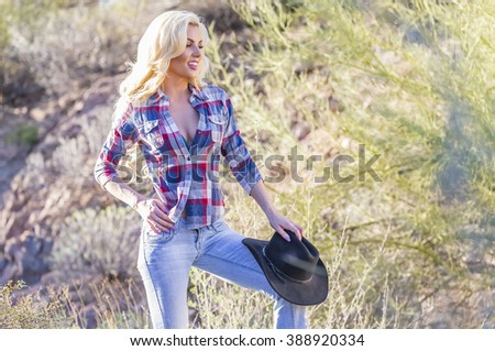 A blonde model posing in the desert of the American Southwest - stock photo
