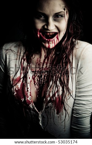 a bloody and scary looking zombie girl - stock photo