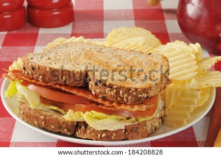 A BLT sandwich on organic sprouted nut and seed bread