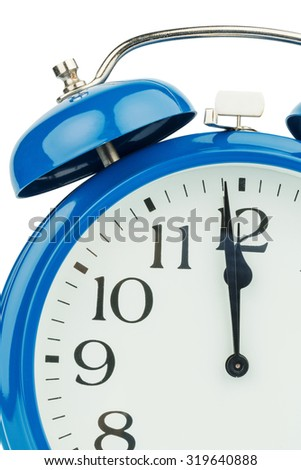 a blue alarm clock on a white background. eleventh hour - stock photo