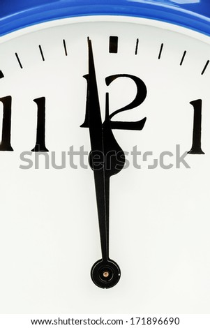 a blue alarm clock on white background. five to twelve - stock photo
