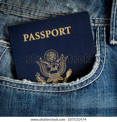 a blue american passport in pocket of jeans - stock photo