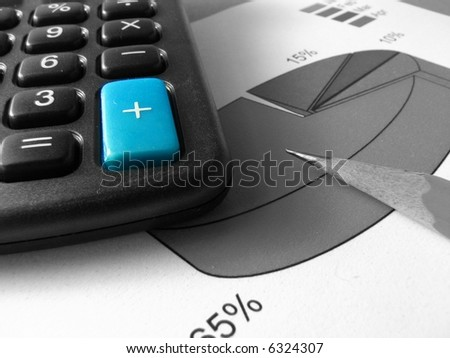 A blue big sum key of a calculator on a black and white photo of a pencil, on top of a pie chart. - stock photo