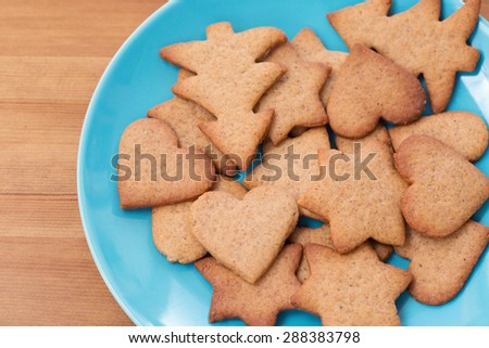 A blue bowl with homemade cookies - stock photo